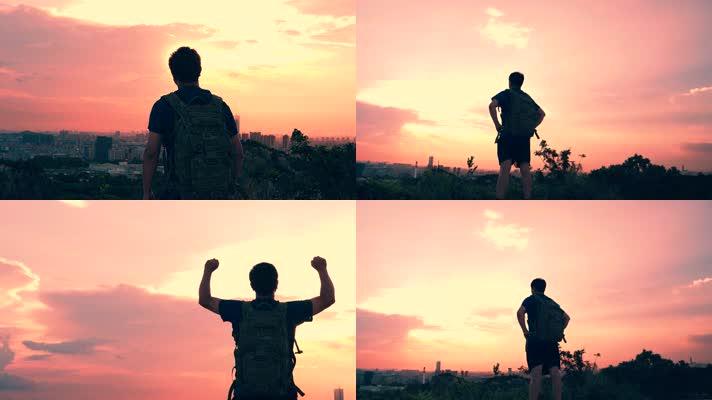 男人登上山顶张开双臂拥抱太阳4k视频素材