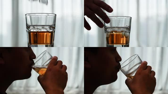 洋酒酒杯加冰块男性喝酒视频素材