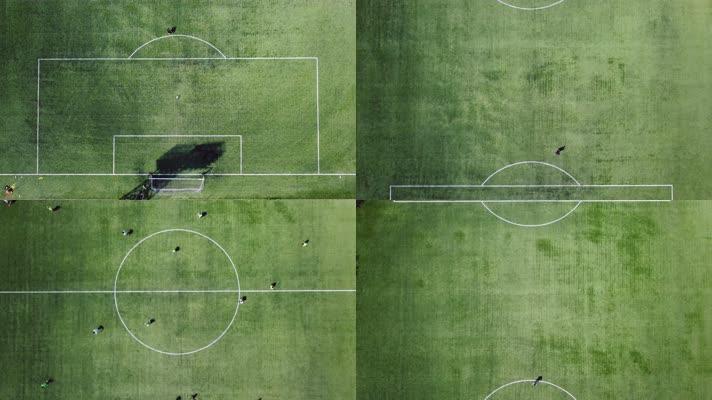 俯拍足球运动员在球场上踢球